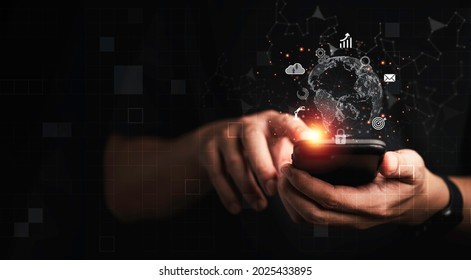 Business man using mobile phone for communication working and transaction ,Global  business by internet connection technology for financial banking , big data and digital linkage concept.