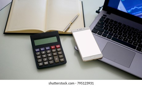 Business man using a mobile phone device with stock graph,checking market data
