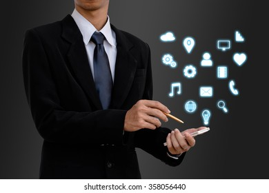Business man using mobile smart phone and icon.
