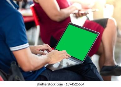 Business man using notbook green screen