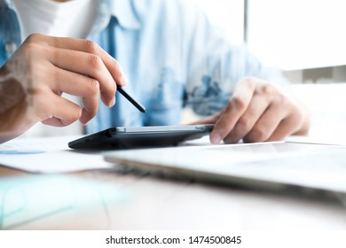 Business man using smart phone and laptop to work at office and Double exposure of people. Business and technology concept