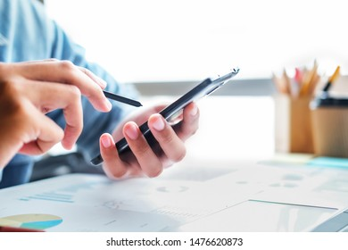 Business man using smart phone and laptop to work at office. Business and technology concept