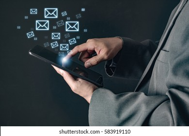 business man using tablet computer and email icons