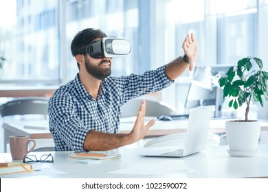 Business man using virtual reality headset in the office
