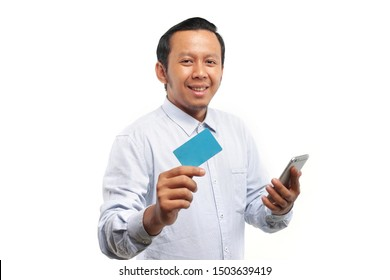 business man vietnam showing credit card with smartphone isolated on white background.