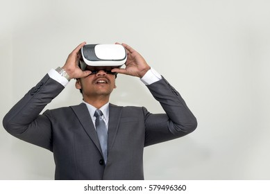 Business man with VR headset device simulation in office.
