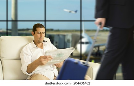 Business man waiting for his flight in the VIP area