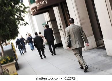 Business man walking down the street