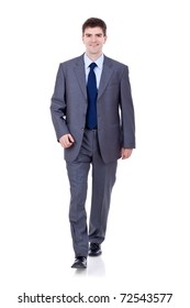 Business man walking and looking to the camera isolated on white