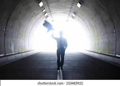 The business man walking in the tunnel