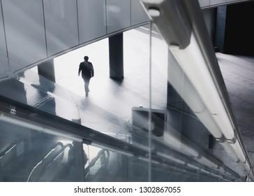 business man walking in urban area