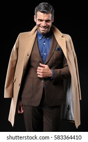 business man wear brown suit on black background