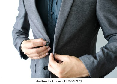 Business man is wearing a black suit and button up in the morning of the working day white background.