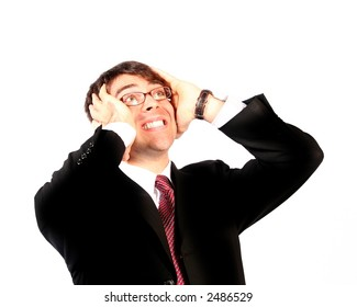 business man wearing glasses with hands on head looking up in anguish