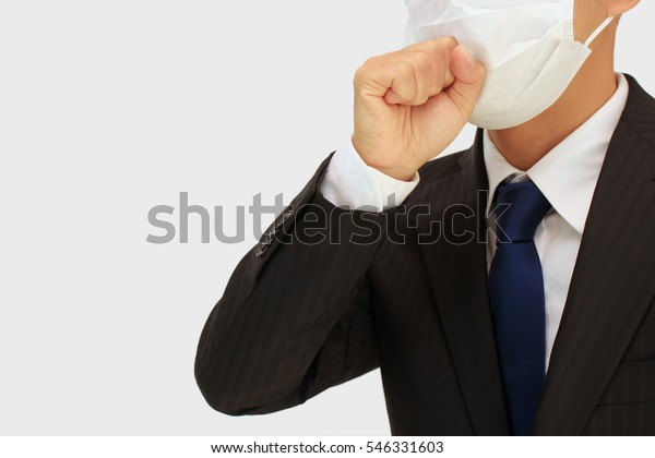 Business man wearing a mask to prevent flu, hay fever