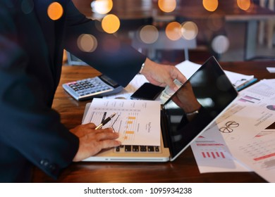 Business man wearing smartwatch using laptop computer. Female working on laptop calculator  in coffee.
