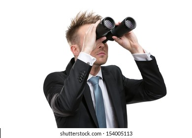 Business man wearing suit with blue tie hands binoculars, isolated