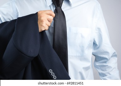 Business man wearing suit with a sweat stained blue shirt on white background