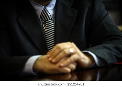 Business man wearing a suit with tie. Detail on the tie.