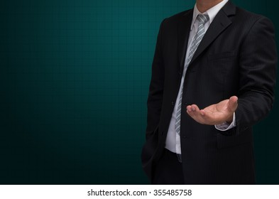 business man with welcome hand in black suite on green background