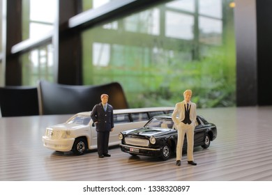 The business man with white limosine car
