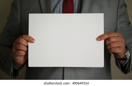 business man with white paper in hands. Best for presentations, business illustrations