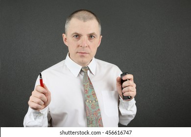 business man in white shirt with red pen and a phone