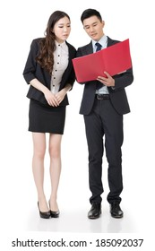 Business man and woman discuss, full length portrait isolated on white background.