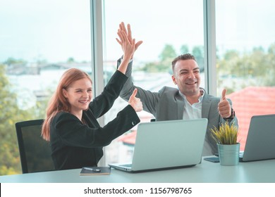 Business man and woman business hi five bump hand together for team work