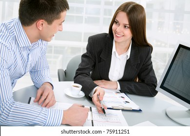 Business man and business woman in a meeting