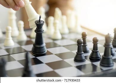 Business man woman play chess use King Chess Piece white to crash overthrow the competitor concept business strategy for win