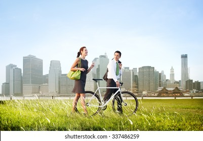 Business Man Woman Pushing Bike City Concept