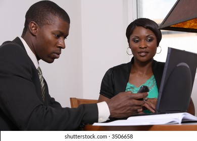 business man and woman at table