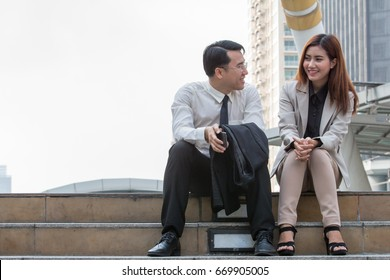 Business man and woman are talking about their work and discuss about their success with happy face