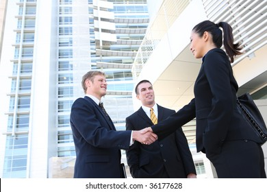 A business man and woman team at office shaking hands