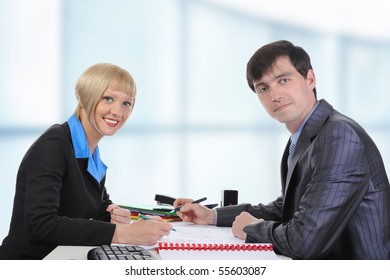 Business man and woman when signing documents.
