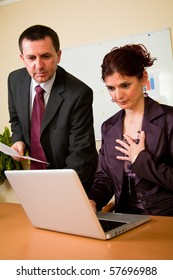 Business man and woman working in laptop in the office