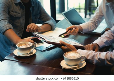 Business man and business woman are working in office , the cup of coffee on the table