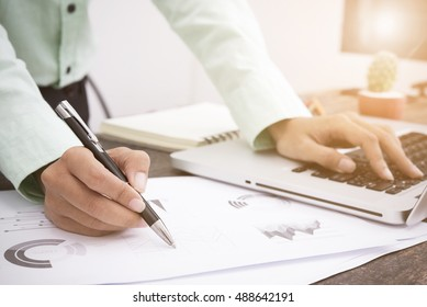 business man working about business investment report on desk office.