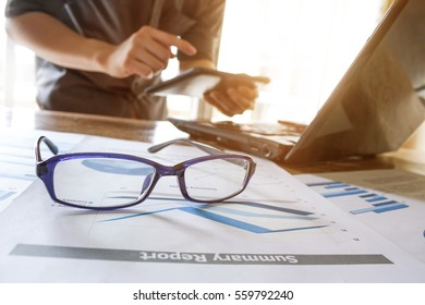 business man working analyzing on graph chart information diagram document on office desk as concept