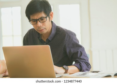 business man working in in coffee shop cafe with laptop paper work  (Business woman concept.)