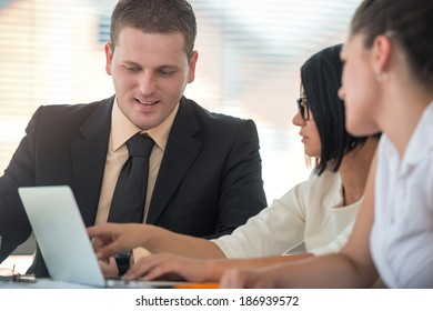Business man working with female colleagues in modern office
