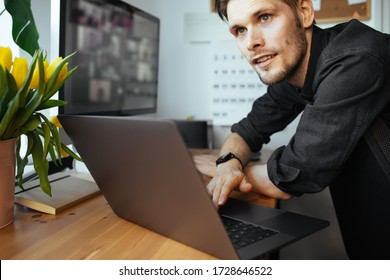 Business man working from home. Young man having video call computer in the home office. Stay at home and work from home concept during Coronavirus pandemic. Virtual house party brainstorming ideas
