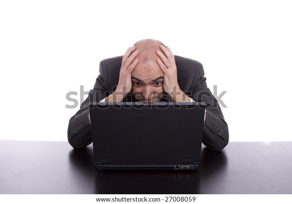 Business man working with laptop, isolated over white