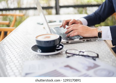 business man working with laptop on the table