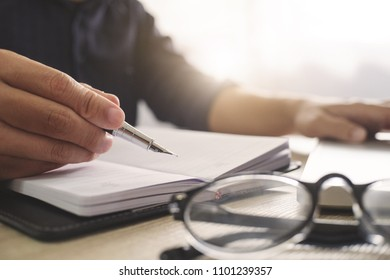 Business man working in a office and documents data