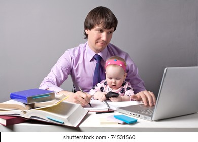 Business man working in the office with his daughter