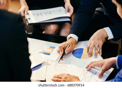 Business man working at office with laptop and documents,businessmen using documents at meeting,Teamwork Togetherness Unity Variation Support Concept,Business team