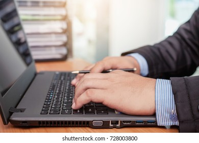 Business man working at office with laptop computer and documents financial reports