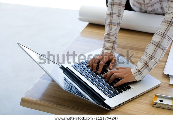 Business man working at office,selective finger on keyboard laptop